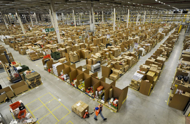Amazon.com announces fourth quarter sales up 15% to $29.33 billion and a net loss of $241 million in 2014