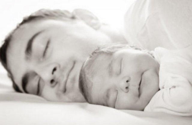 Father sleeping with son