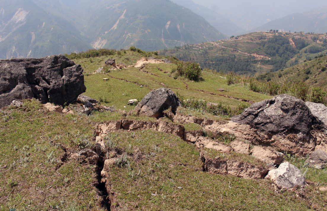 Large ground cracks on a small ridge and landslide in the background after the Nepal quake of April 2015, upper Bhote Koshi river valley, photo: O. Marc, GFZ