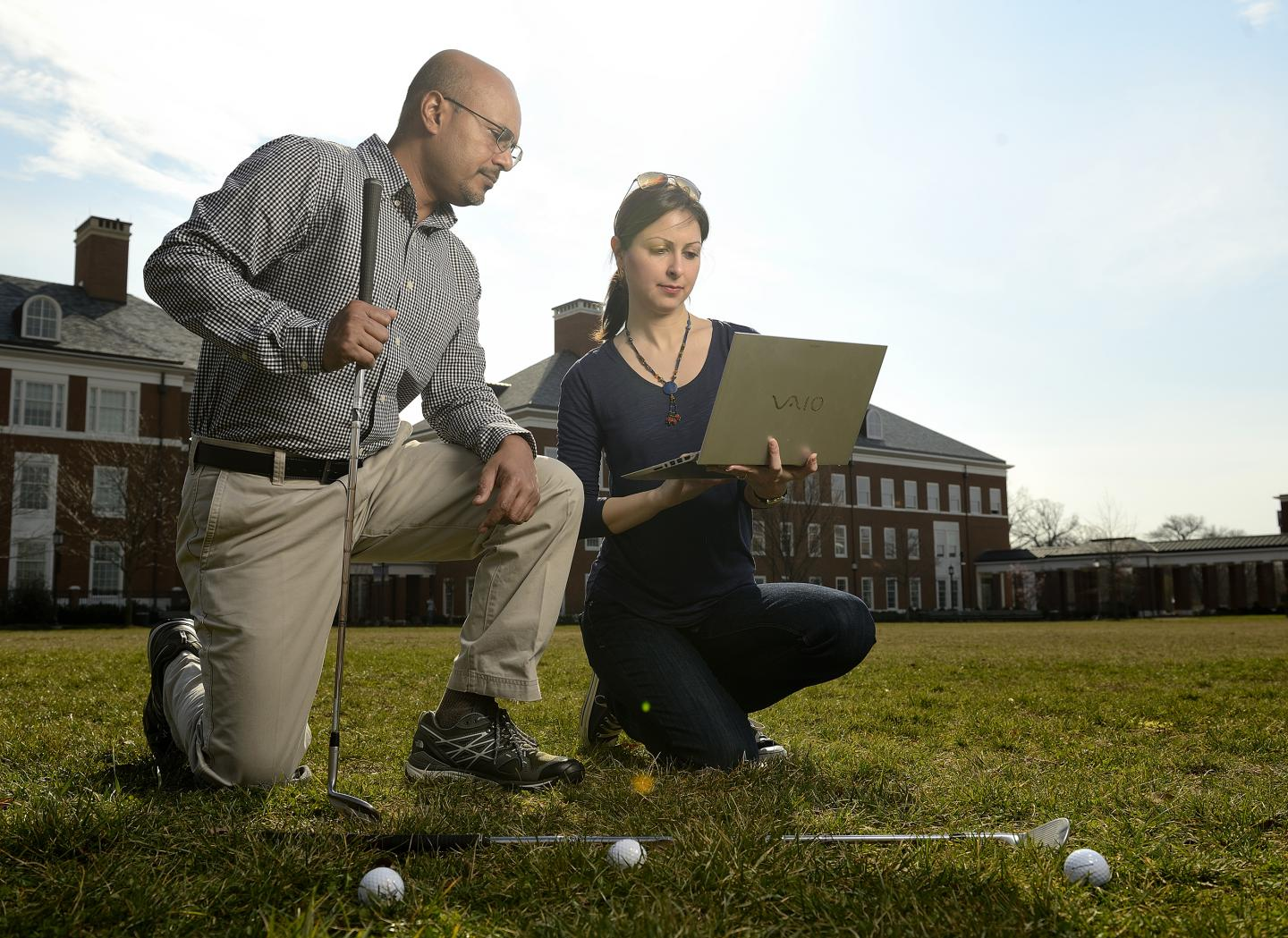 Rajat Mittal, left, a Johns Hopkins mechanical engineering professor, and Neda Yaghoobian, a visiting postdoctoral scholar, devised a computer simulation to determine how wind conditions affect the of trajectory of the ball.