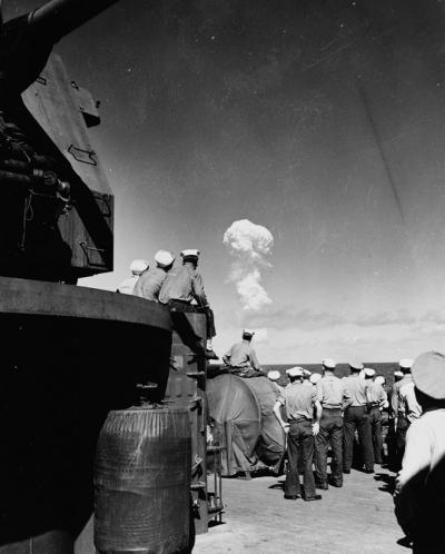 Sailors watched the Able Test burst miles out to sea from the deck of the support ship USS Fall River on July 1, 1946. Credit: Naval History and Heritage Command