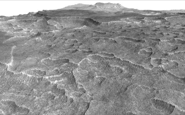 This vertically exaggerated view shows scalloped depressions in a part of Mars where such textures prompted researchers to check for buried ice, using ground-penetrating radar aboard NASA's Mars Reconnaissance Orbiter. Credit: NASA/JPL-Caltech/Univ. of Arizona