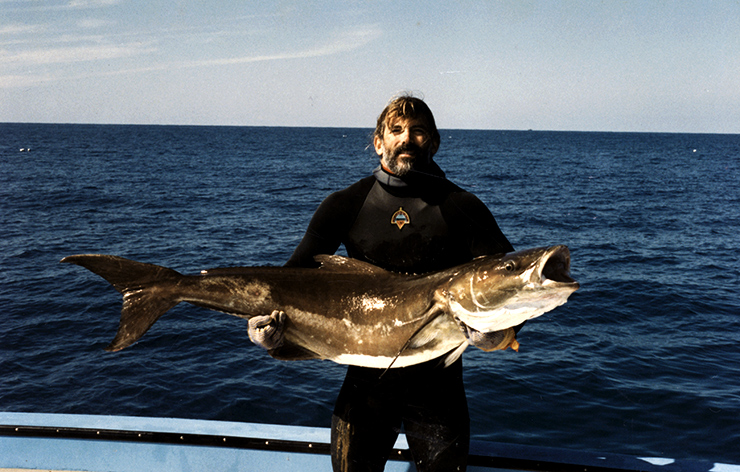 fisherman holds cobia